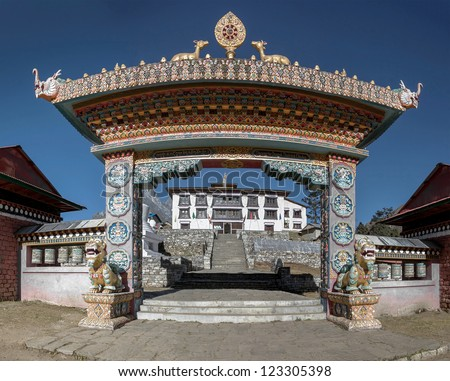 The front gate of the monastery Tengboche who guard the mythical animals - Nepal, Himalayas - stock photo
