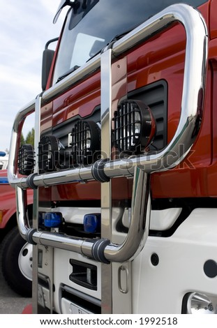 The front of a fire truck with chrome bumper and lights - stock photo
