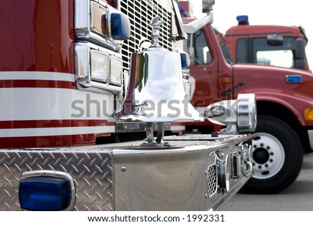The front of a fire truck with chrome trim and bell
