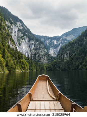 The front of an old Austrian Boat on a lake and hills and mountains in the distant. - stock photo