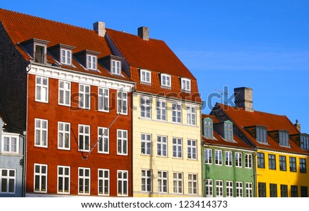 The front of colorful buildings next to Nyhavn Waterfront
