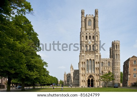 The front of the beautiful Ely Cathedral with trees