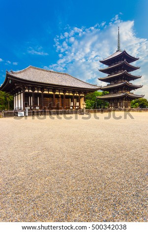 The front of the East Golden Hall, To-kondo, and five story pagoda, Goju-no-to, on beautiful blue sky day at Kofuku-ji Temple in Nara, Japan. Vertical copy space