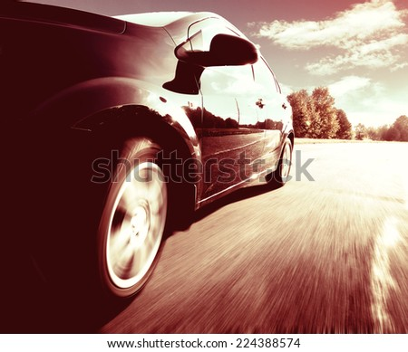 The front side view of black car in turn. - stock photo