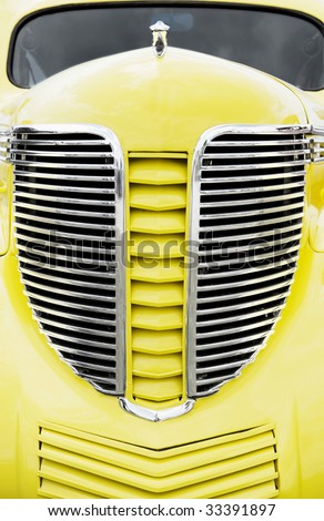 The front view of a vintage yellow Desoto pickup taken at a vintage swap and car show, July 30 2007, Markham, Ontario - stock photo