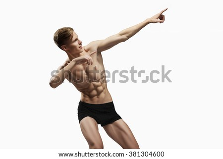 the front view of the brawny young man in studio the isolated white background