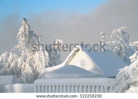 The frozen and become covered with hoarfrost rural house in a strong frost, Russia, Siberia - stock photo