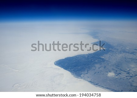 The frozen coast of Newfoundland from high altitude.  - stock photo