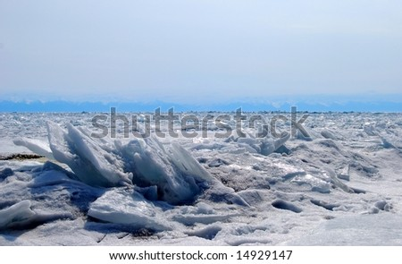 The frozen lake in winter - stock photo