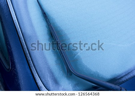 The frozen rear window of a Danish car after a cold November night. Space for text. - stock photo