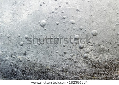 The frozen water surface - stock photo