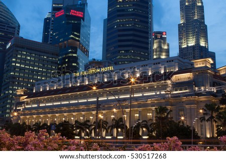 the Fullerton hotel, Singapore , November 16,2013, at night , and background of buildings