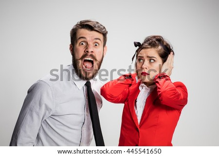 The funny business man and woman communicating on a gray background. Business concept of relationship of colleagues - stock photo