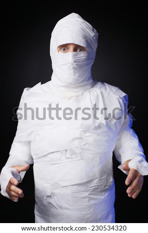 The funny mummy from toilet paper - stock photo