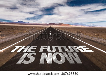 The Future is Now written on desert road - stock photo