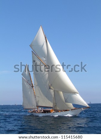 The Gaff Ketch  are two masts and the sails are square. The taller mast forward is known as the mainmast. This one was in the regatta the Sails of St Tropez. - stock photo