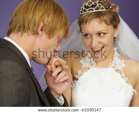 The gallant groom kisses her hand happy bride - stock photo