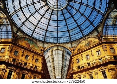 The Galleria Vittorio Emanuele II. The dome above arcades. Shopping Center in Milan, Italy. - stock photo