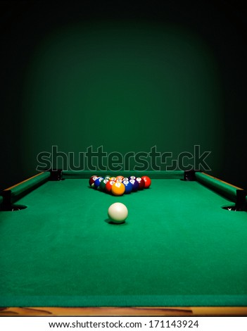 The game of billiards on a table with green cloth - stock photo