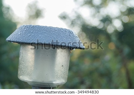 the garden lamp on solar batteries in a green garden among plants  - stock photo