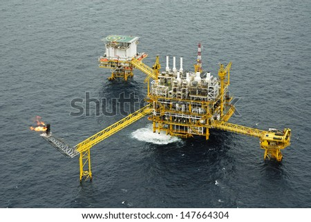 The gas flare is on the oil rig platform in the gulf of thailand, Aerial view  - stock photo