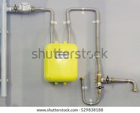 the gas meter on gray wall