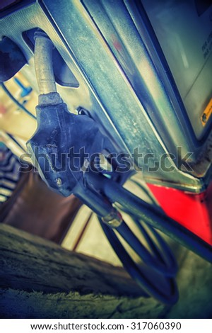 the Gas pump nozzles in the retro service station, vintage effect - stock photo