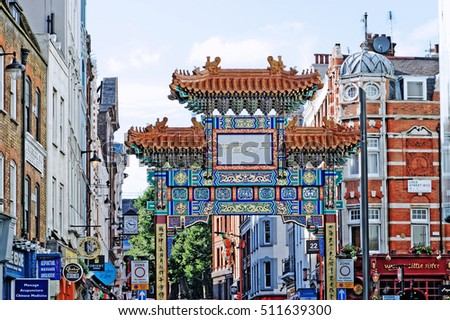 "The Gate in Chinatown, London, England with glazed yellow tiles, a golden dragon, painted panels, two white jade plaques and gold foil. The Chinese text translates ""Peace and Prosperity to Chinatown"""