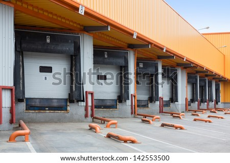 The gate to load goods on a large warehouse - stock photo
