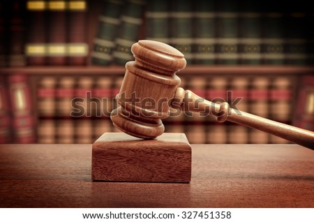The gavel of a judge in court - stock photo