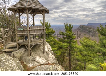 The gazebo at Artist's Rock with Eagle Cliffs in the background above Mohonk Lake in the Shawangunk Mountains of New York - a famous location for Hudson River School painters. - stock photo