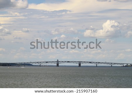 The George P Coleman memorial bridge as seen from the USCG training center pier in Yorktown Virginia on the York River looking wet towards west point up river inland - stock photo