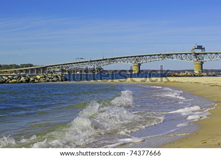 The George P Coleman Swing Span Bridge over the York river in Virginia with Yorktown Beach in the foreground with room for your text.