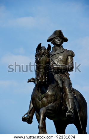 The George Washington statue at the Public Garden in Boston, MA against a blue sky with plenty of copy space. - stock photo