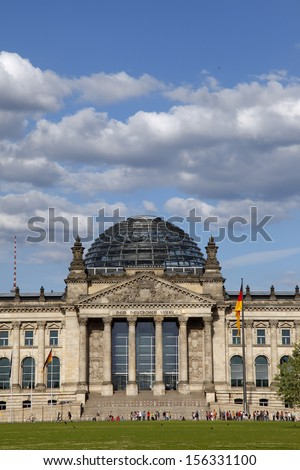 The German Bundestag is the national Parliament of the Federal Republic of Germany. Its seat is the Reichstag Building in Berlin. The national flag in front of the Building.  - stock photo