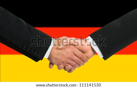 The German flag and business handshake - stock photo