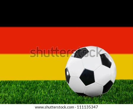 The German flag and soccer ball on the green grass