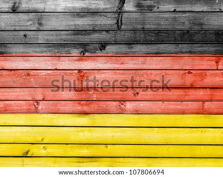 The German flag painted on wooden fence - stock photo