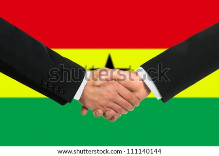 The Ghana flag and business handshake - stock photo