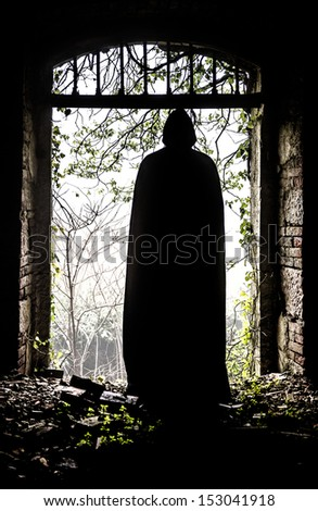The ghost appears through the gate - stock photo