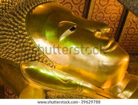 The giant Reclining Buddha in Wat Pho, Thailand - stock photo