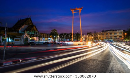 The Giant Swing and wat Suthat at dusk in Bangkok, Thailand. Here is one of the most famost landmark in Bangkok. - stock photo