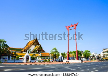 The giant swing (Sao Ching Cha) and Wat Suthat temple in Bangkok, Thailand - stock photo