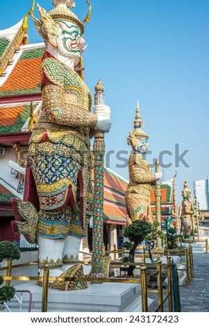 The giants statue in Wat Pra Kaew, The Grand Palace, blue sky, Bangkok Thailand