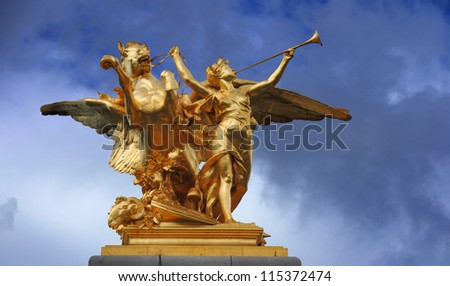 The gilded sculpture symbolise agriculture on the bridge Alexandre III in Paris, France. - stock photo