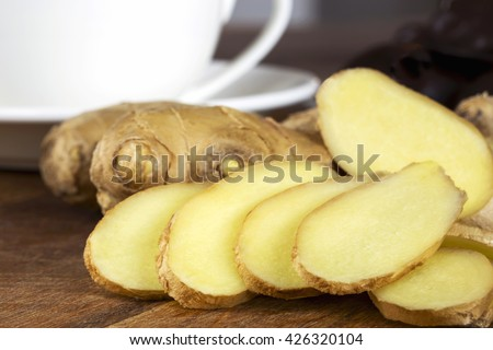 the ginger root on a wooden table - stock photo