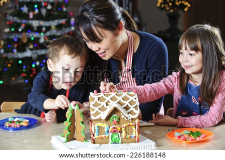 the gingerbread fun / is not just for the children / but also for mom - stock photo