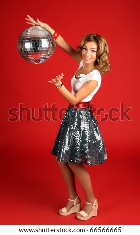 The girl and disco ball on red background - stock photo