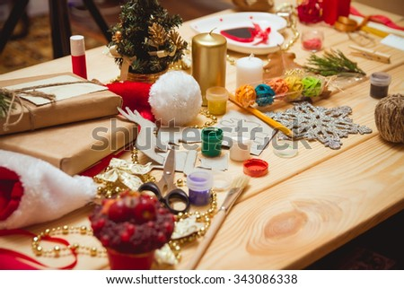 The girl at the table makes Christmas gifts. Hand made - stock photo