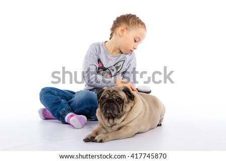 The girl cares for the dog scratching, listening to the stethoscope. isolated background